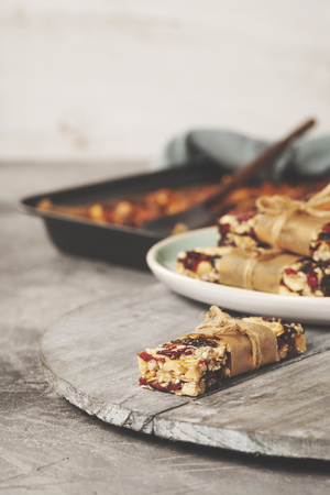 Granola bar on a grey rustic table. Healthy energy snack