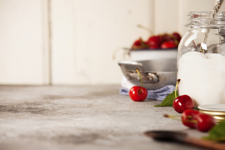 Ingredients for sweet cherry jam on rustic table Stock Photo