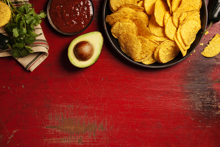Mexican nachos chips with salsa sauce on rustic background. Mexican food concept