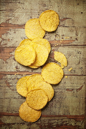 Nachos chips on rustic wooden background. Mexican food concept Stock Photo