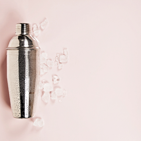 Cocktail shaker on pink background