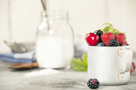 Ingredients for making berry jam on rustic background Stock Photo