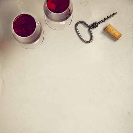 Wine over grey concrete background. Top view, copy space
