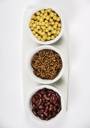Bowls  of various legumes on white background Stock Photo