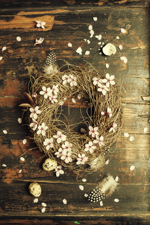 Easter egg wreath on a wooden background