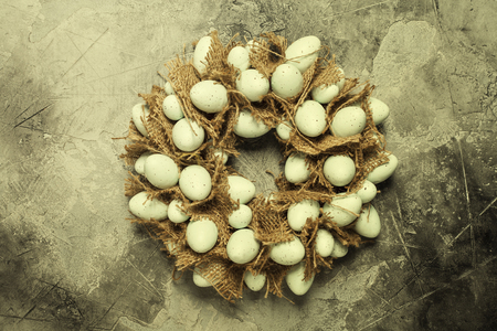 Easter egg wreath on a grey stone background