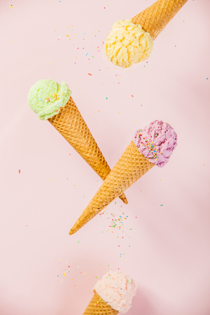 Colorful  Ice Cream in a waffle cones on pink background Reklamní fotografie