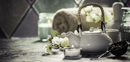 Asian tea set and spa settings on stone background near the old window. Natural spa treatment and relaxation concept Stock Photo