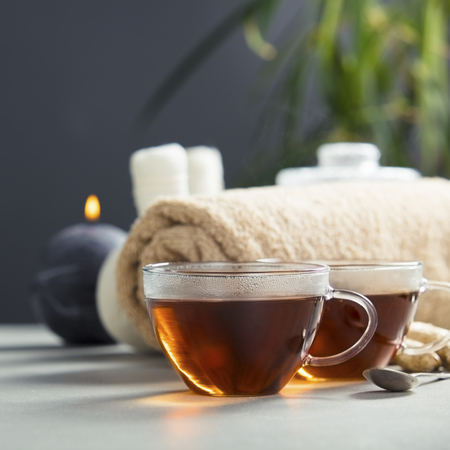Tea set and spa settings on concrete background. Natural spa treatment and relaxation concept