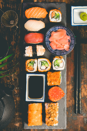 Flat-lay of sushi set on old wooden background 스톡 콘텐츠