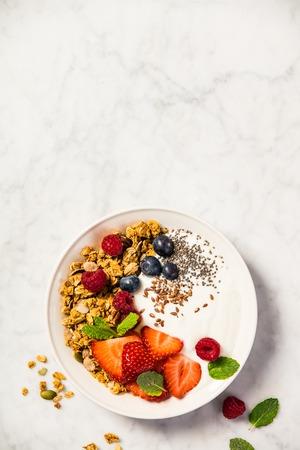 Bowl of homemade granola with yogurt and fresh berries Stock fotó - 101676666