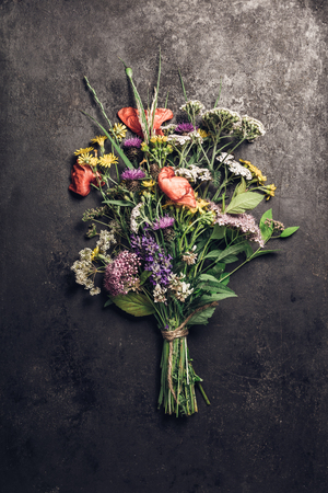 Wild flower bouquet on vintage background. Top view, flat lay Stock fotó