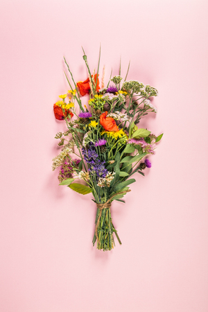 Wild flower bouquet on pastel color background. Top view, flat lay 스톡 콘텐츠 - 103129652