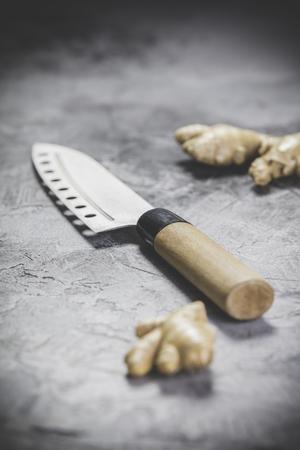 Fresh ginger and knife