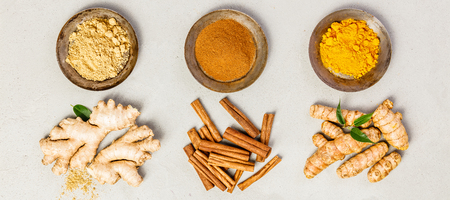 Ginger, turmeric and cinnamon - Spices for healthy drinks - turmeric tea or golden turmeric latte. Top view, copy space Stock Photo