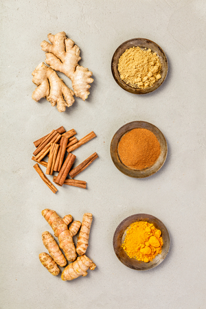Ginger, turmeric and cinnamon - Spices for healthy drinks - turmeric tea or golden turmeric latte. Top view, copy space Banco de Imagens