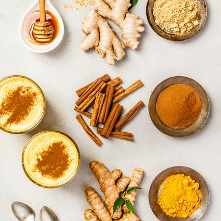Healthy drinks - turmeric tea or golden turmeric latte. Top view, flat lay Banco de Imagens