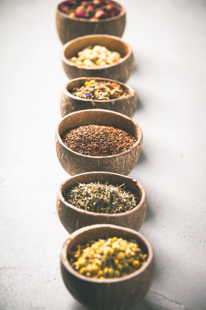 Assortment of dry tea in coconut bowls.