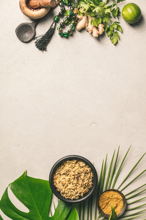 Couscous, green leaf and cooking ingredients Stock Photo