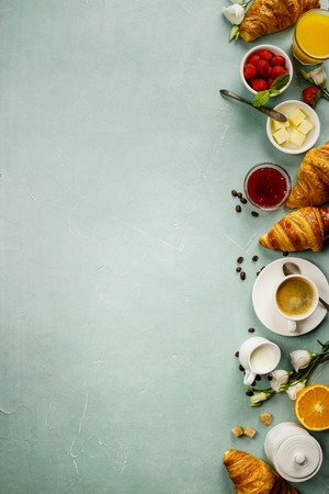 Continental breakfast captured from above - space for text