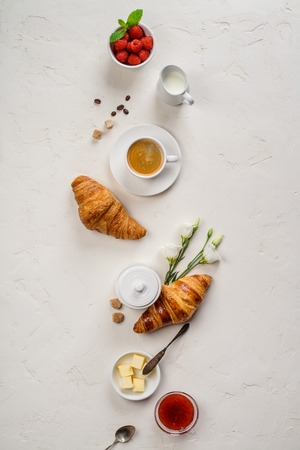 Continental breakfast captured from above - on concrete background