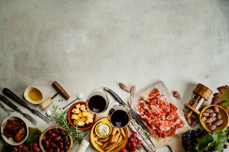 Wine and tapas on concrete background, top view Stock Photo