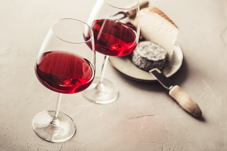 Red wine and cheese on concrete background 스톡 콘텐츠