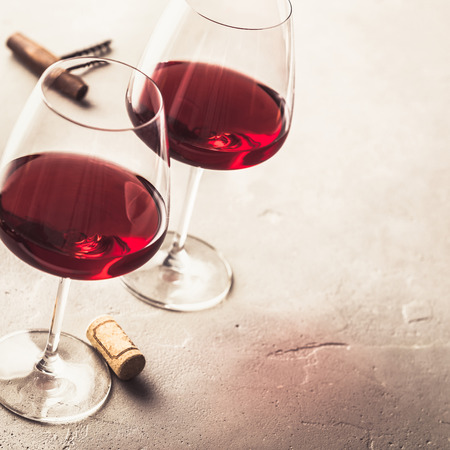 Red wine and cheese on concrete background Standard-Bild