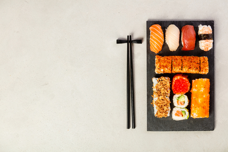 Flat-lay of sushi set, space for text Stock Photo