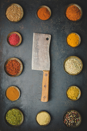 Various bowls of spices and meat knife Фото со стока