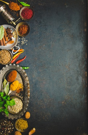 Herbs and spices on dark background - turkish, indian, asian cooking concept, flat lay, space for text Фото со стока