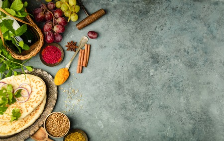 Middle eastern or arabic tradition ingredients - kebab bread, meat, wine, herbs and spices. Space for text, flat lay Stock Photo