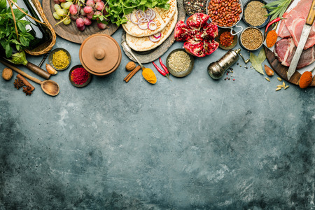 Middle eastern or arabic tradition ingredients - kebab bread, meat, wine, herbs and spices. Space for text, flat lay Фото со стока