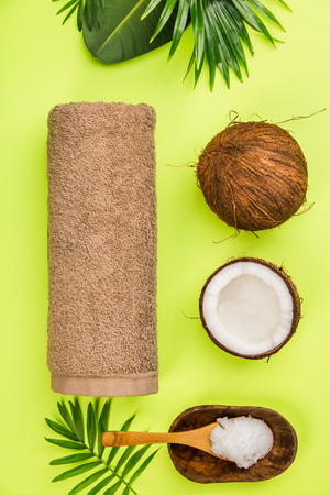Coconut oil, tropical leaves and fresh coconuts, flat lay, healthy life concept