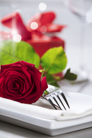 Valentines Day or Romantic dinner concept. Valentine day or proposal background. Close up view of restaurant table with romantic table place setting. Copy space 写真素材