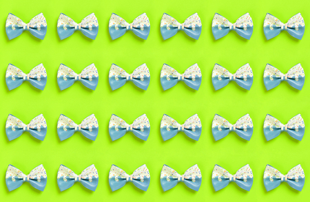 Colorful hair bow pattern on green Stock Photo