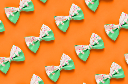 Colorful hair bow pattern on orange