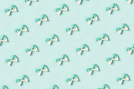 Colorful hair bow pattern on pastel blue