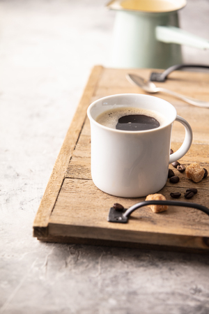 A cup of coffee on light grey Archivio Fotografico - 116248276
