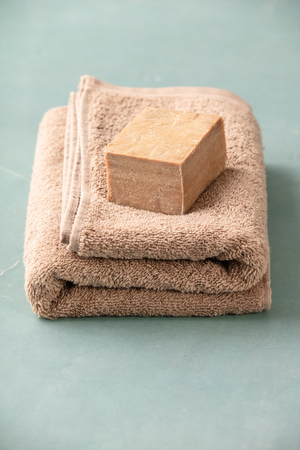 Soap and towel close up, SPA and relaxation concept
