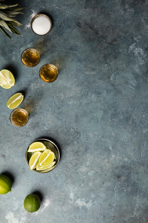 Gold tequila with lime and salt, flat lay, space for text