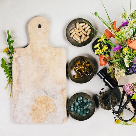 Flat lay of wild healing herbs and flowers. Clean eating, paleo, biohacking, herbal medicine concept