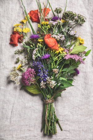 Wild flower bouquet on vintage linen