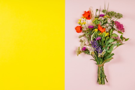 Wild flower bouquet on pink and yellow