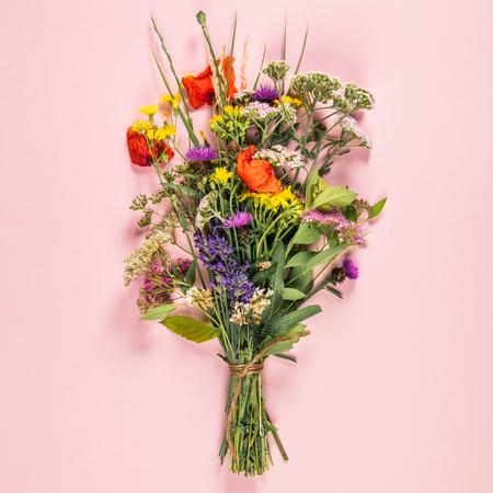 Wild flower bouquet on pastel color Stock fotó