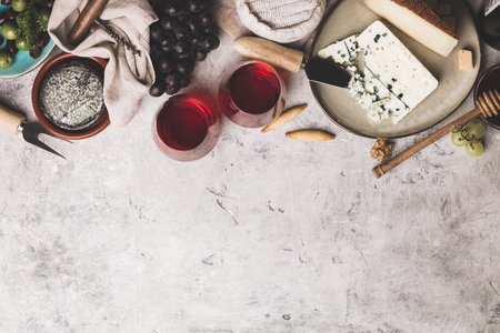 Red wine with charcuterie assortment on rustic concrete background, flat lay, copyspace Reklamní fotografie - 119052068