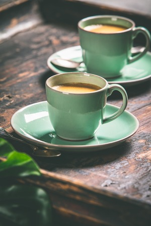 Cups of coffee  on wooden background
