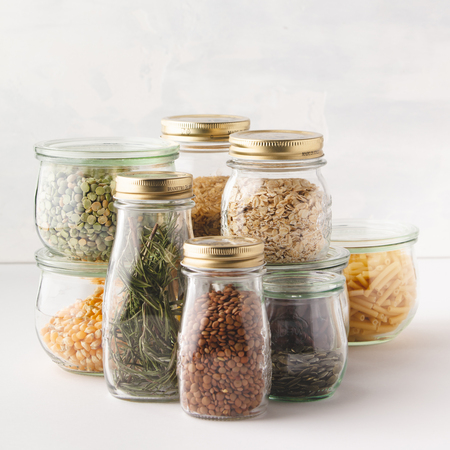 glass jars with pasta, lentils, beans, rice, dry herbs. Zero waste, Recycling, Sustainable lifestyle concept