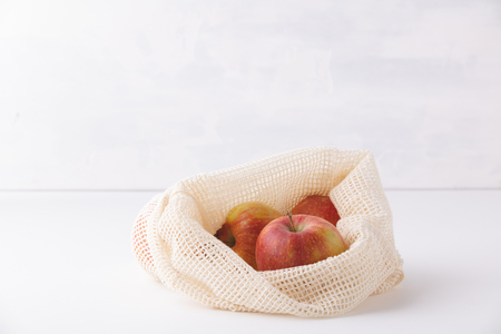 Red apples in reusable cotton bags. Zero waste, Recycling, Sustainable lifestyle concept Stok Fotoğraf