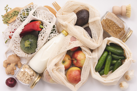 Zero waste concept. Eco bags with fruits and vegetables, glass jars with beans, lentils, pasta. Eco-friendly shopping, flat lay Stok Fotoğraf